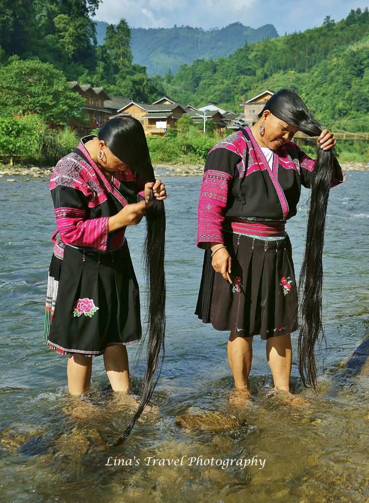 Long hair Yao womens, here sisters-in-law, in Yao Ethnic Huangluo Village. Longji Rice Terracces, Guangxi, China