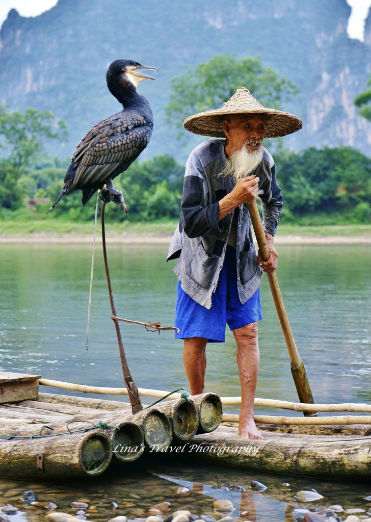 Cormorant fishermen, Mr Huang Quande 88 years old, at Li River in Yangshuo Guangxi China